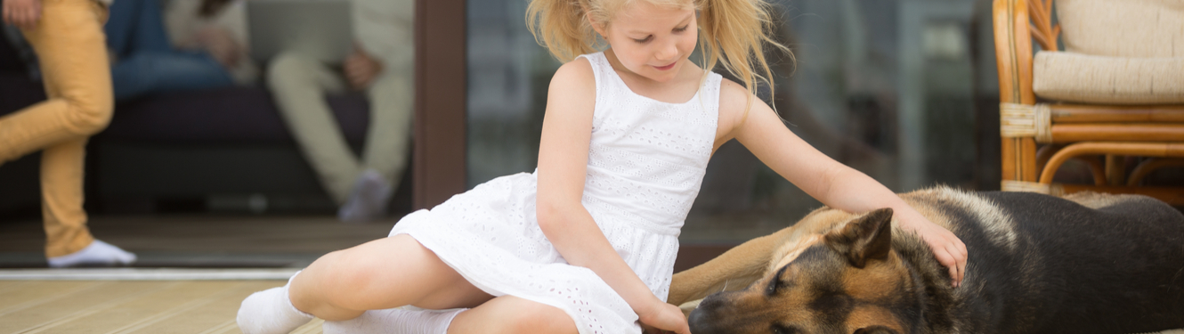 Image of little girl with dog.